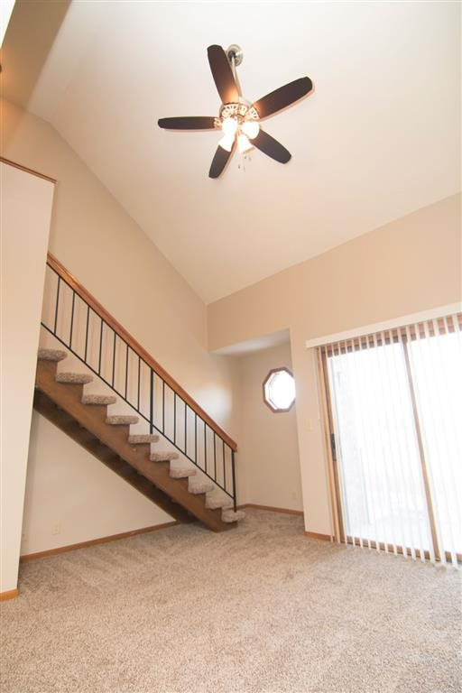 interior and stairs with ceiling fan at Fountain Glen Apartments in Lincoln Nebraska