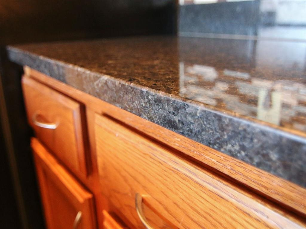 Renovated kitchen counter and cabinets at Fountain Glen Apartments in Lincoln Nebraska