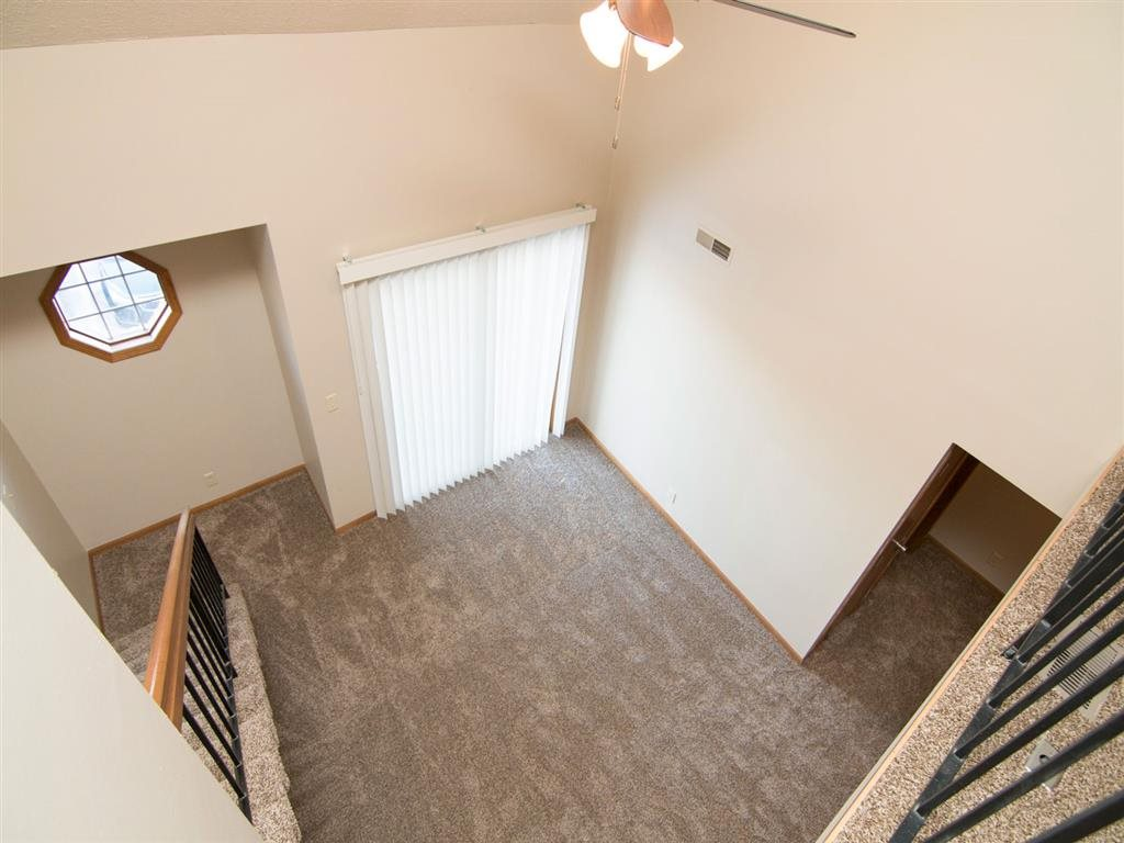 View looking down at the living space from the loft at Fountain Glen Apartments in Lincoln Nebraska