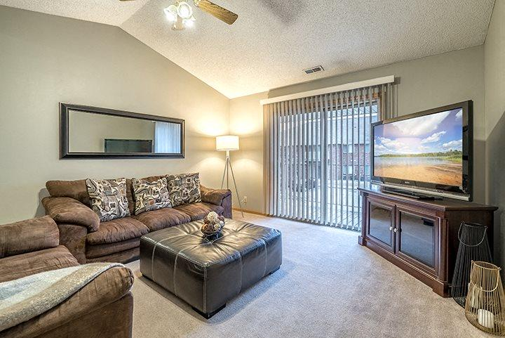 Living room with large sliding doors at Fountain Glen Apartments