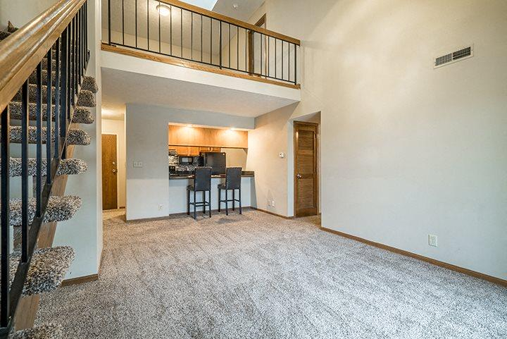 Open concept loft floorplan with view off living room and loft at Fountain Glen Apartments