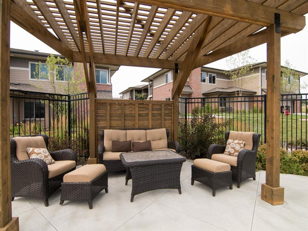Outdoor lounge area cabana by the pool at North Pointe Villas