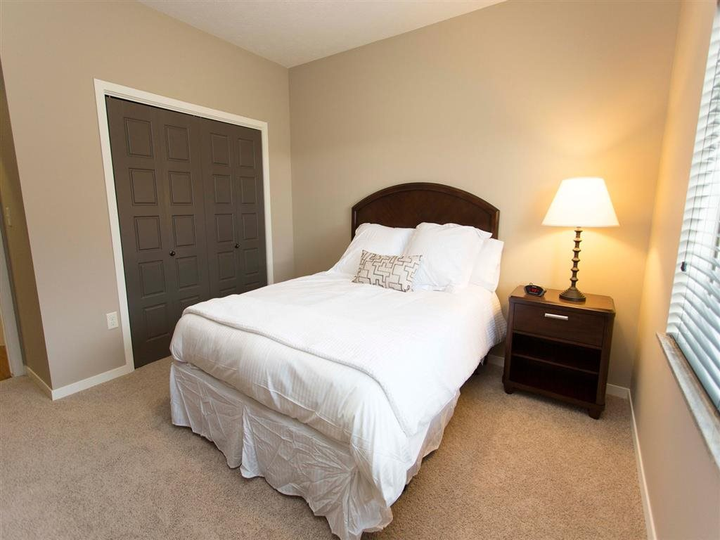 Bedroom with closet and large window for natural light at North Pointe Villas