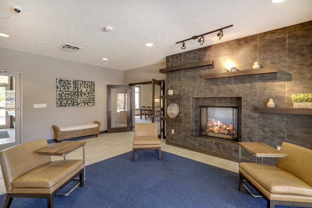 Leasing lounge in clubhouse with fireplace at North Pointe Villas luxury townhomes for rent in north Lincoln NE