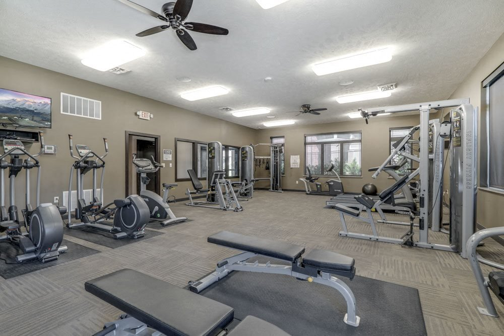 Fitness center with strength and cardio equipment at North Pointe Villas