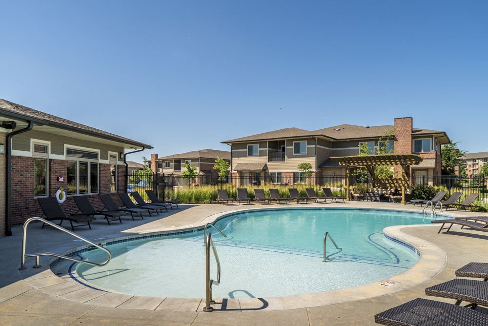 Resort style pool with lounge chairs at North Pointe Villas in Lincoln