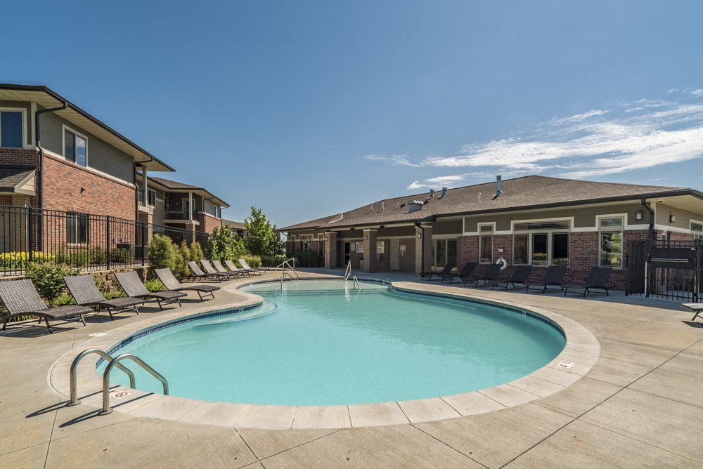 Pool with lounge chairs at North Pointe Villas