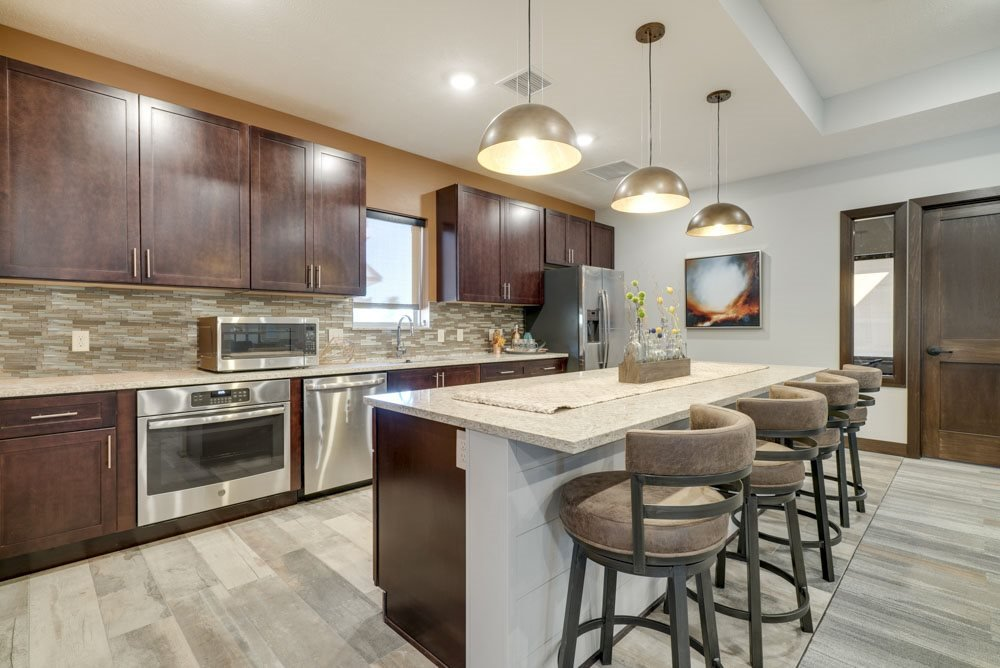 Kitchen with seating at North Pointe Villas' new west clubhouse in north Lincoln