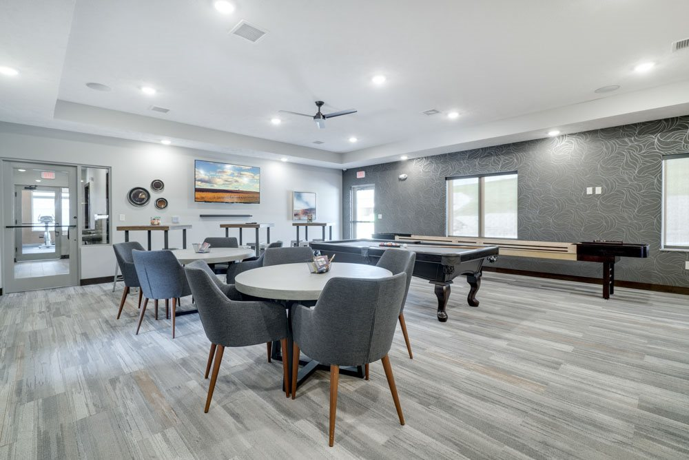 New west clubhouse great room with games at North Pointe Villas luxury apartments and townhomes in north Lincoln NE