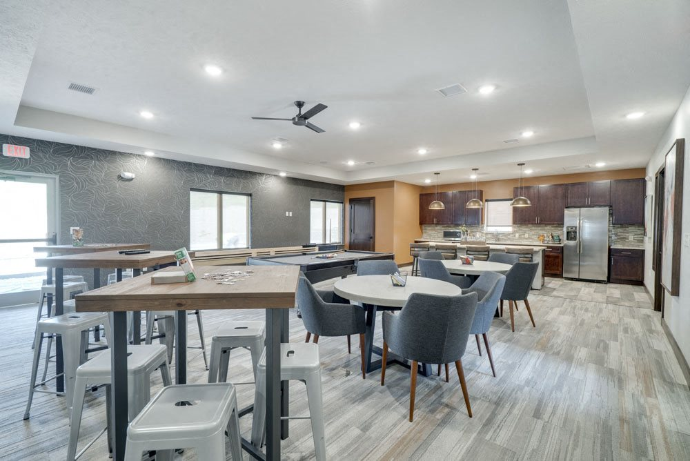 New west clubhouse with plenty of seating at North Pointe Villas luxury apartments and townhomes in north Lincoln NE
