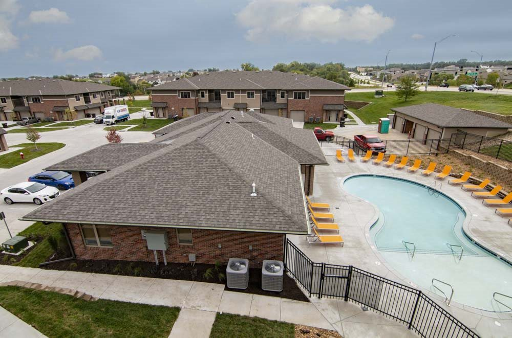 Aerial view of the resort-style pool view at North Pointe Villas luxury townhomes and apartments in Lincoln NE