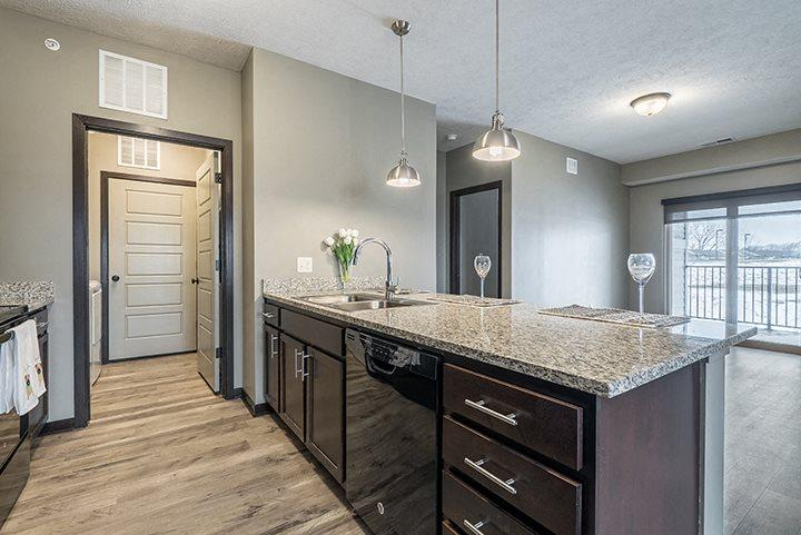 Kitchen with granite counters and island at North Pointe Villas