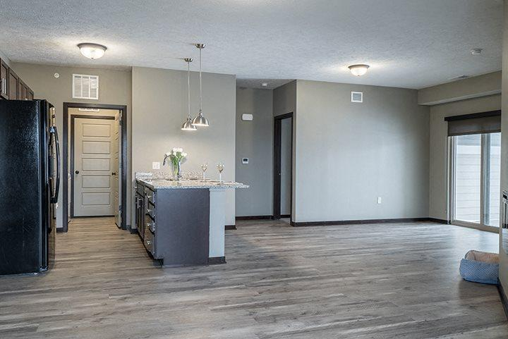 Large windows and natural lighting in large open floor plan kitchen and living space at North Pointe Villas