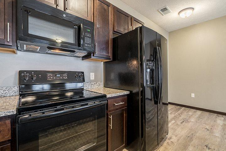 Kitchen with GE appliances and microwave at North Pointe Villas