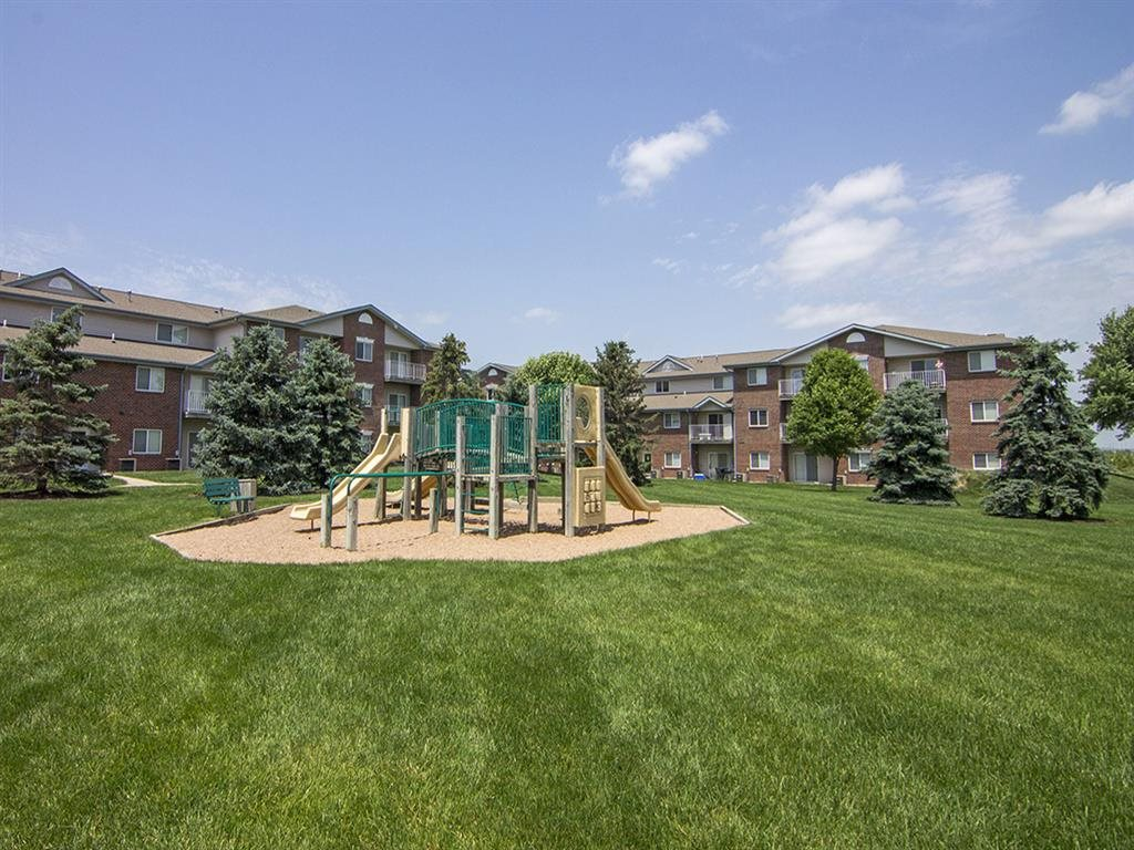 Playground and grass at Northridge Heights apartments in Lincoln