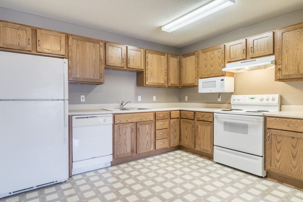 Kitchen with white appliances and lots of cabinet storage at Northridge Heights in north Lincoln