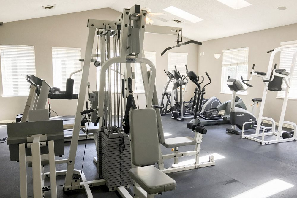 Fitness center with cardio and strength equipment at Northridge apartments in Lincoln, NE