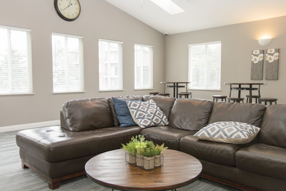 Clubhouse with sectional couch for residents to hang out at Northridge Heights