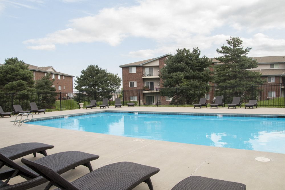 Swimming pool with lounge chairs at Northridge Heights apartments in North Lincoln