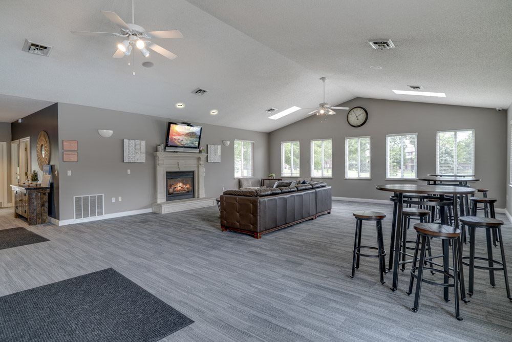 Clubhouse with seating areas, TV, and fireplace at Northridge Heights Apartments
