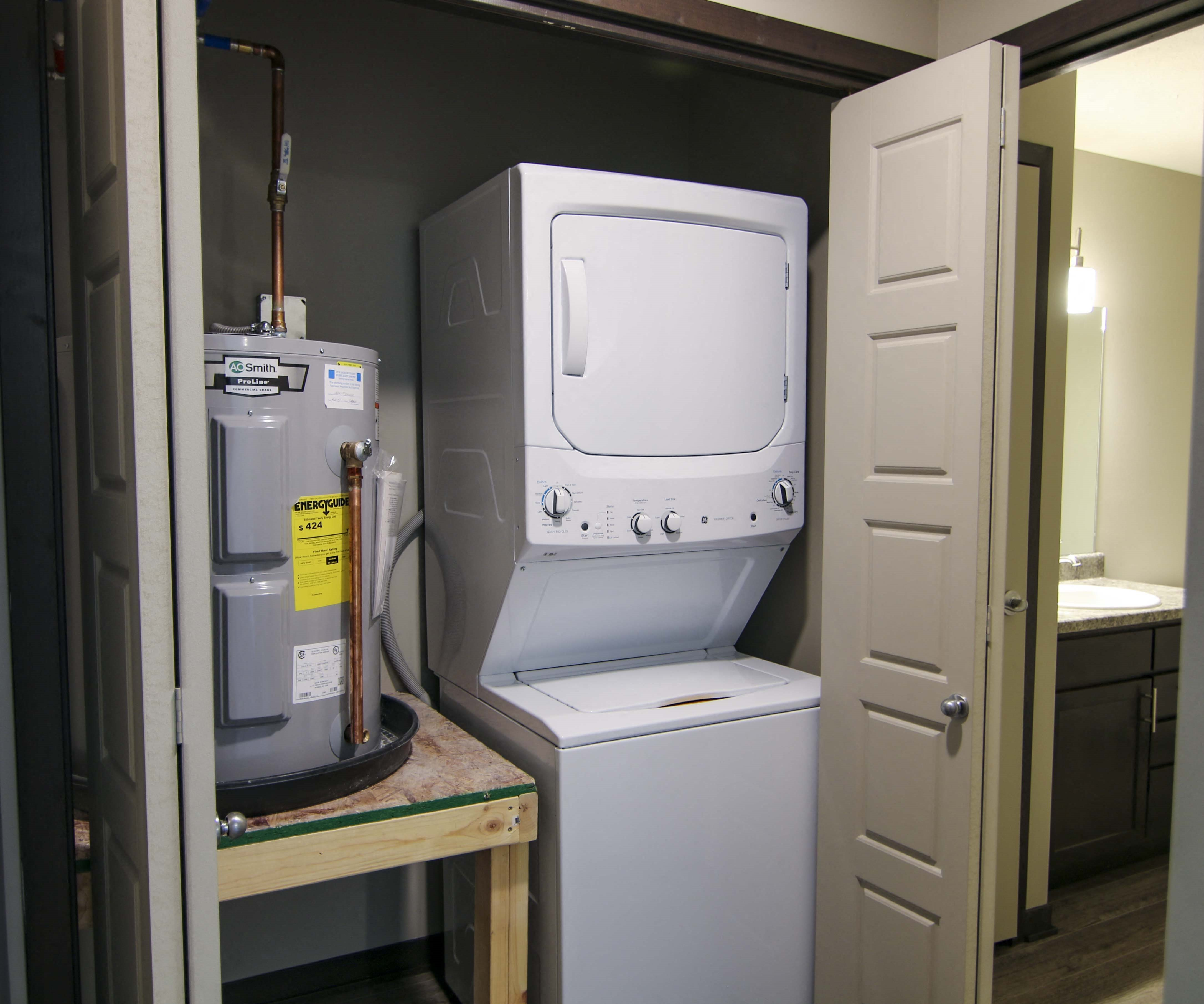 Stacked washer and dryer off bathroom at Northridge Heights in Lincoln
