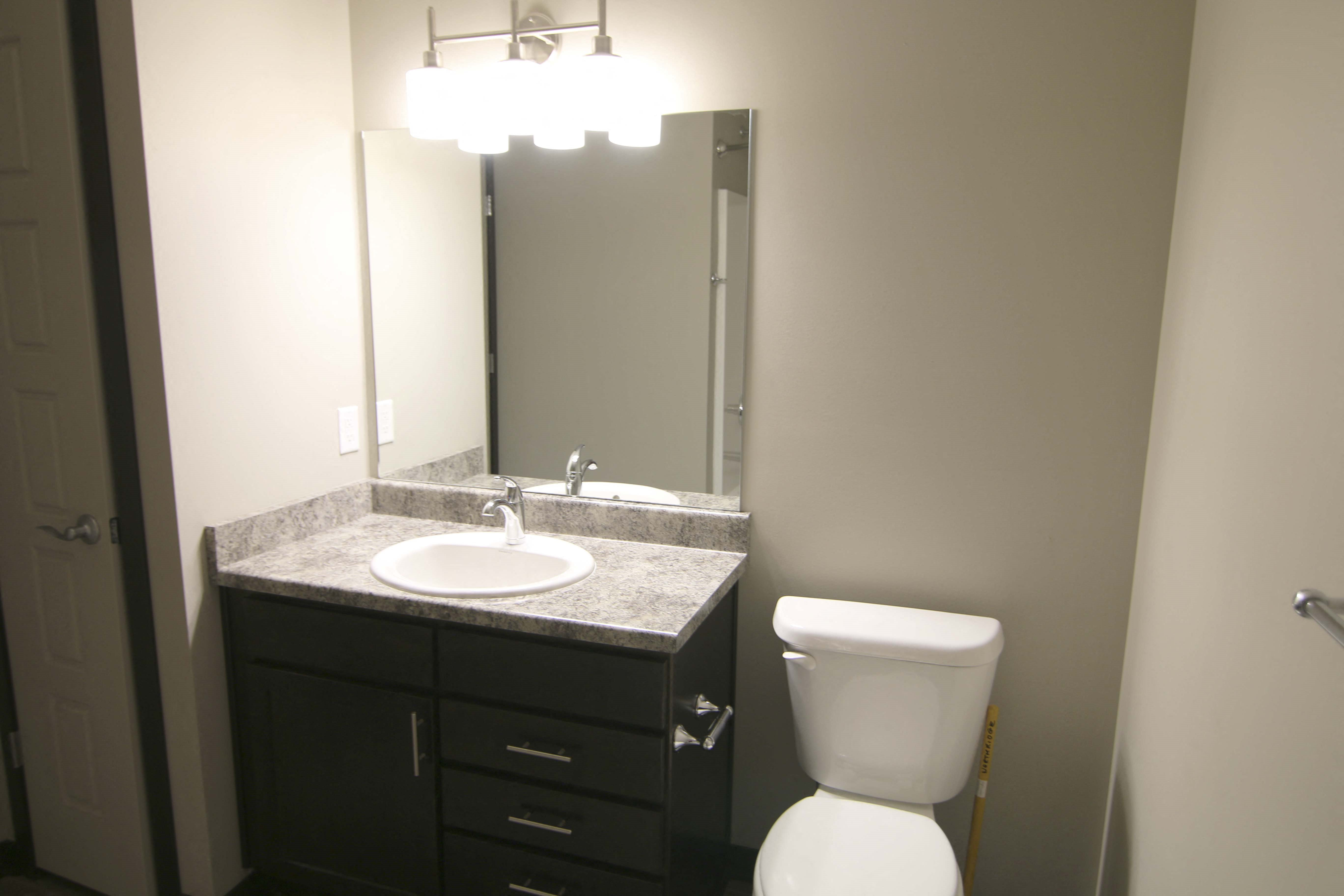 Renovated bathroom with linen storage closet at Northridge Heights in north Lincoln