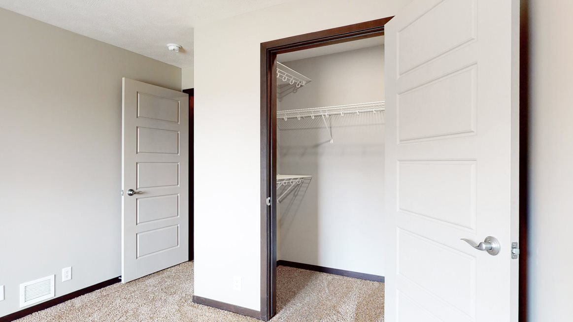 Bedroom with large walk in closet for storage in Northridge Heights apartments in Lincoln