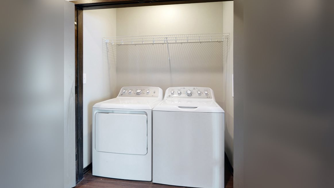 Full size washer and dryer and laundry room included at Northridge Heights Apartments