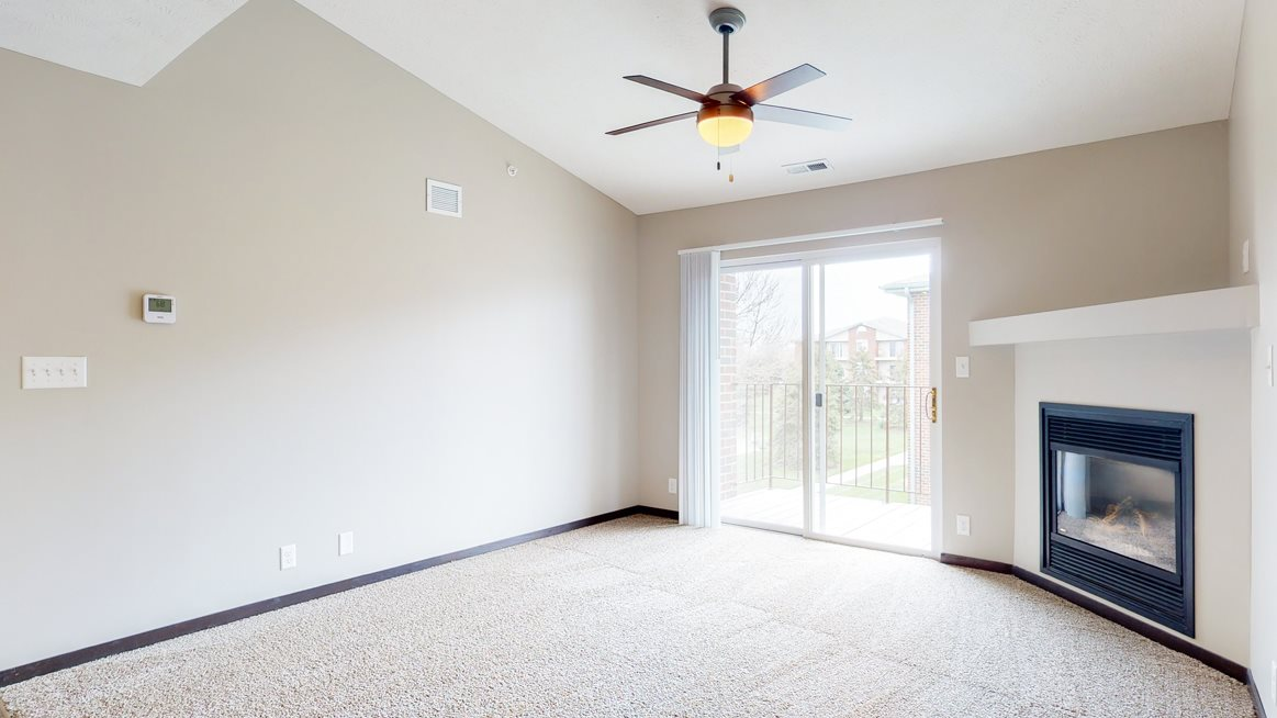 Renovated living room with high ceilings and gas fireplace at Northridge Heights in Lincoln