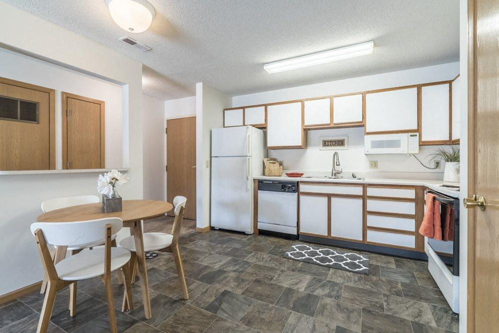 Large kitchen with attached dining area at Northridge Heights in north Lincoln