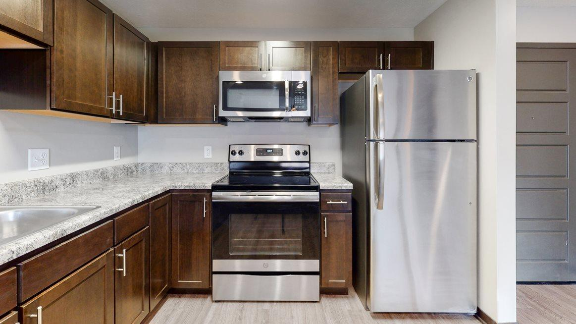 Renovated kitchen with granite and many cabinets for lots of storage