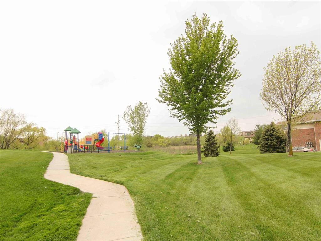 Walking trails and playground at the Northbrook Apartment Homes in Lincoln NE