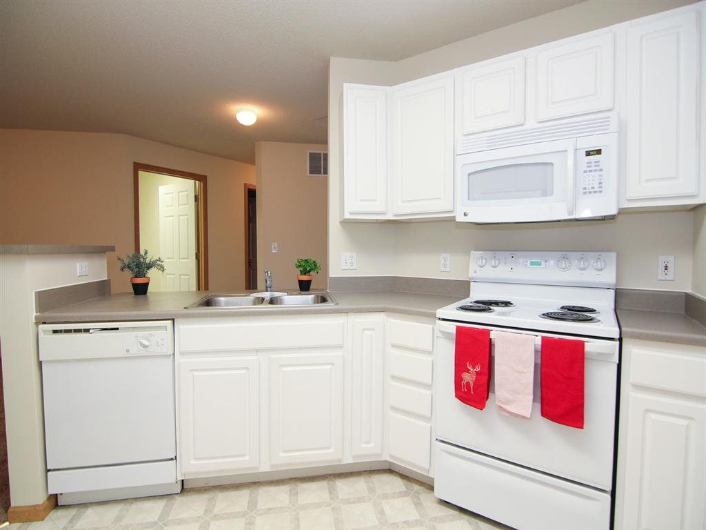 Kitchen with stove and dishwasher at Northbrook Apartments in Lincoln NE