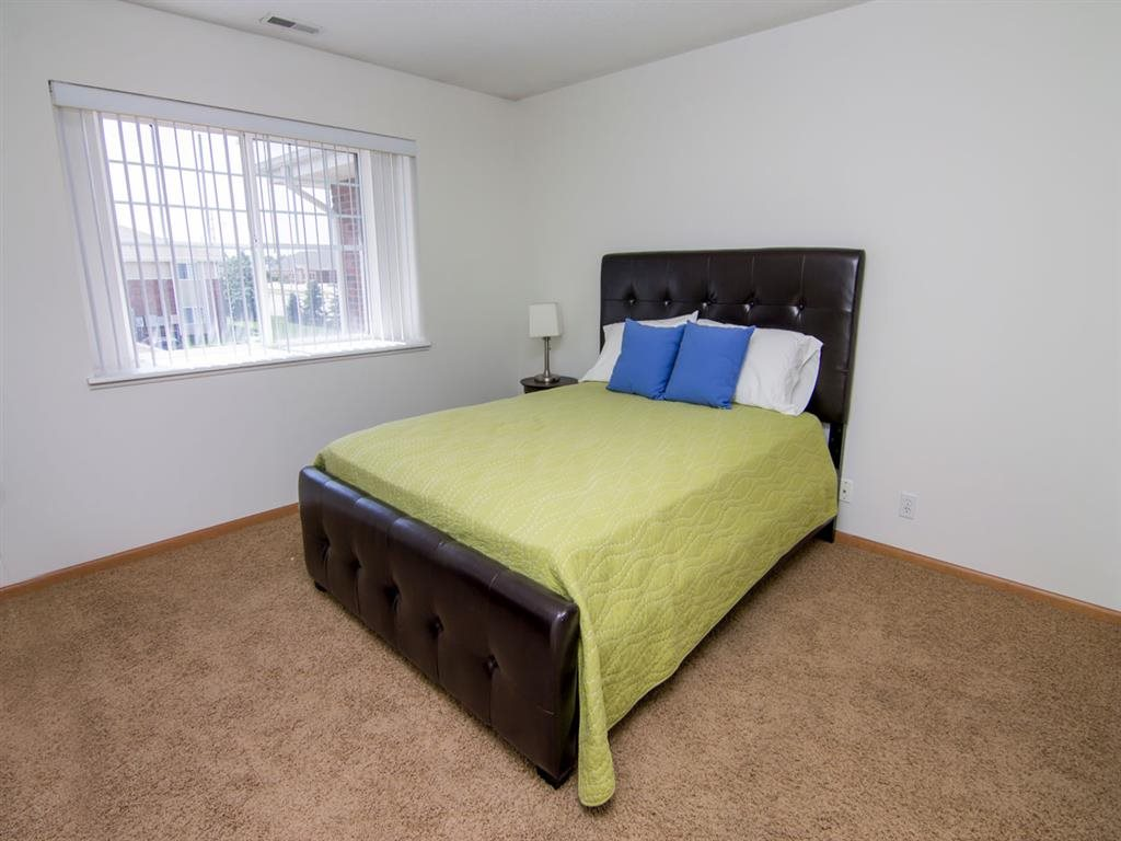 Bedroom with large window in The Northbrook Apartments in Lincoln NE