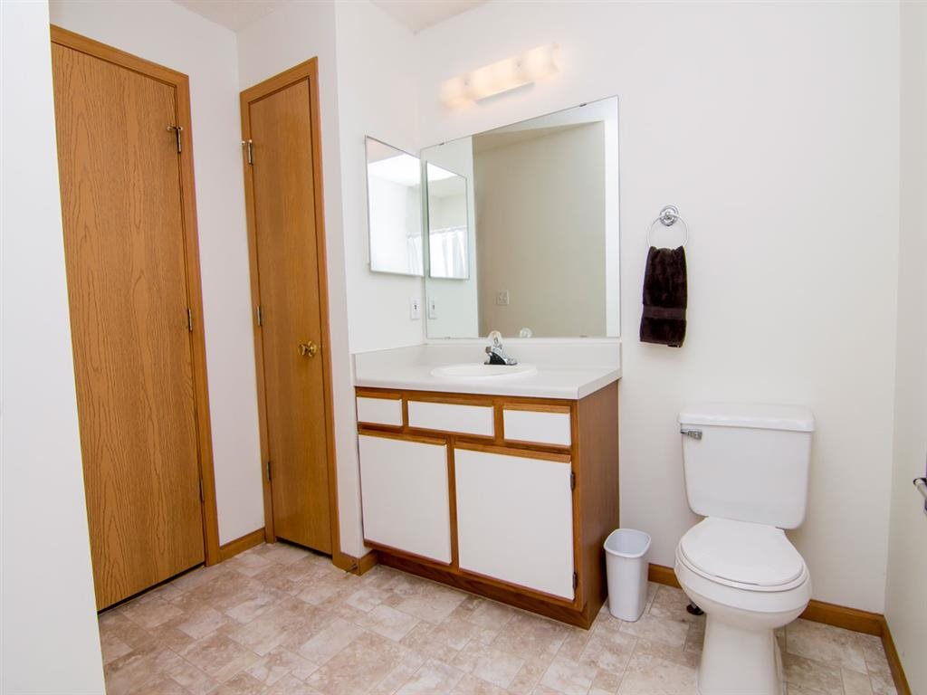Spacious bathroom with linen closet storage at Northbrook Apartments in Lincoln NE