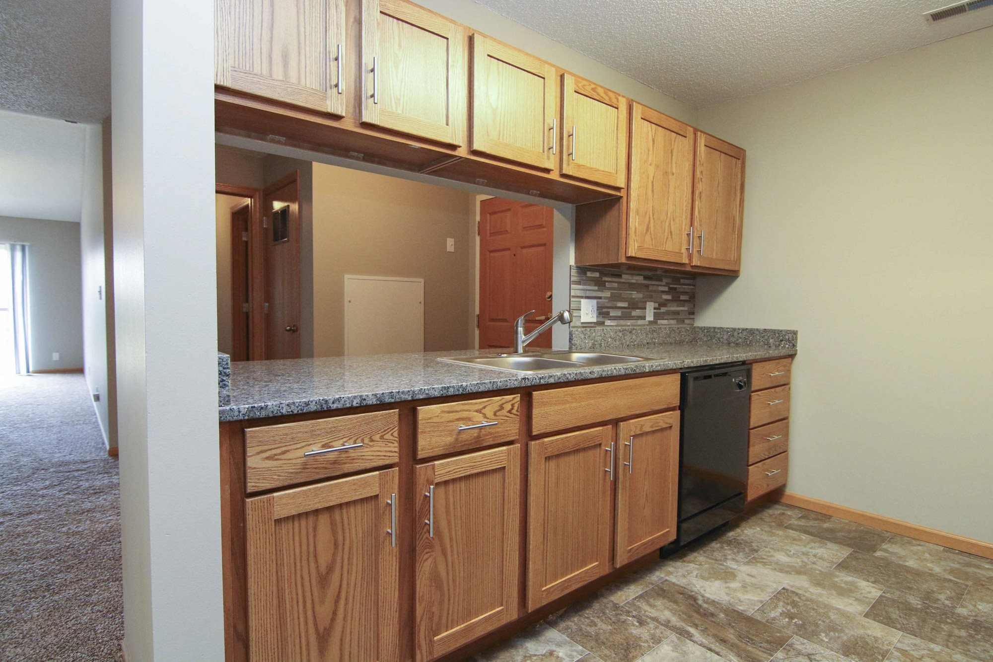 Renovated kitchen with granite counters and new appliances at Northbrook Apartments