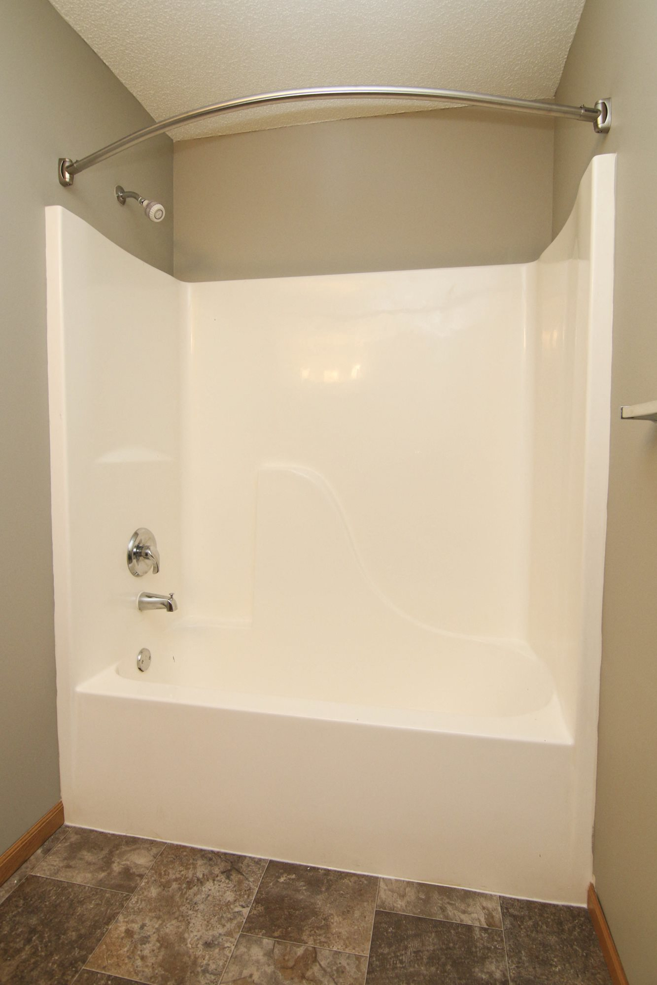 Brand new shower and bathtub in renovated bathroom at Northbrook Apartments