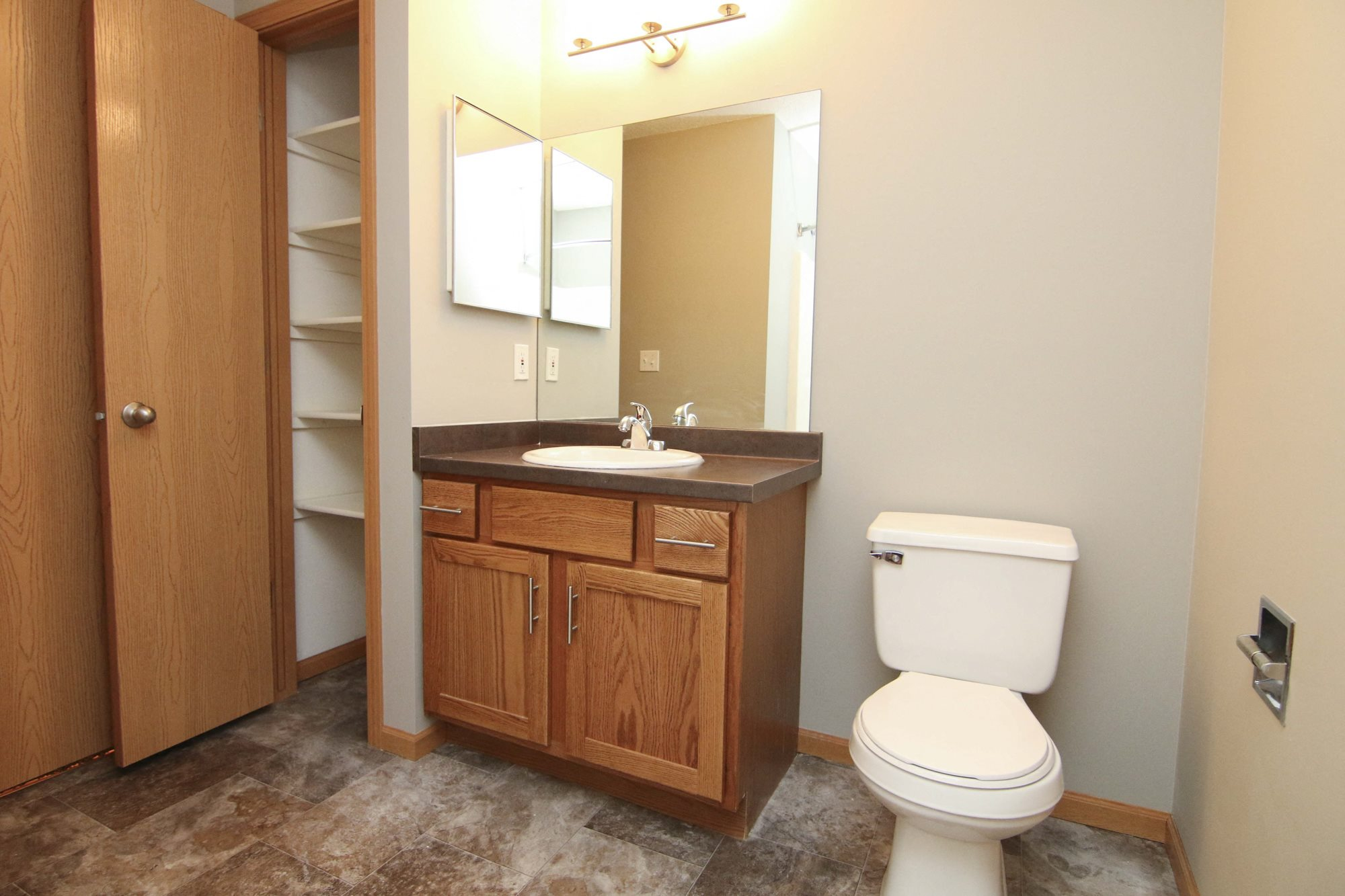 Renovated bathroom with linen storage closet at Northbrook Apartments