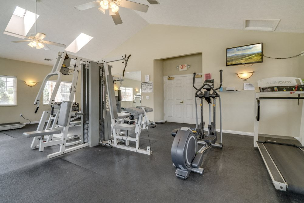 Fitness center with cardio and resistance equipment at The Northbrook Apartments