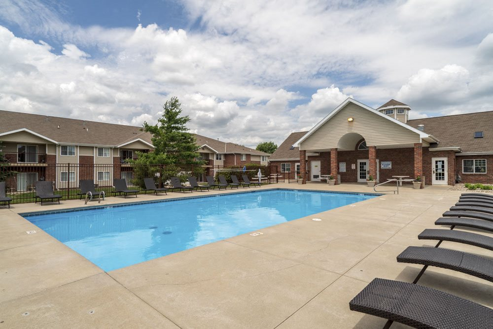 Large outdoor pool with lounge chairs at The Northbrook Apartments in Lincoln, NE 68504