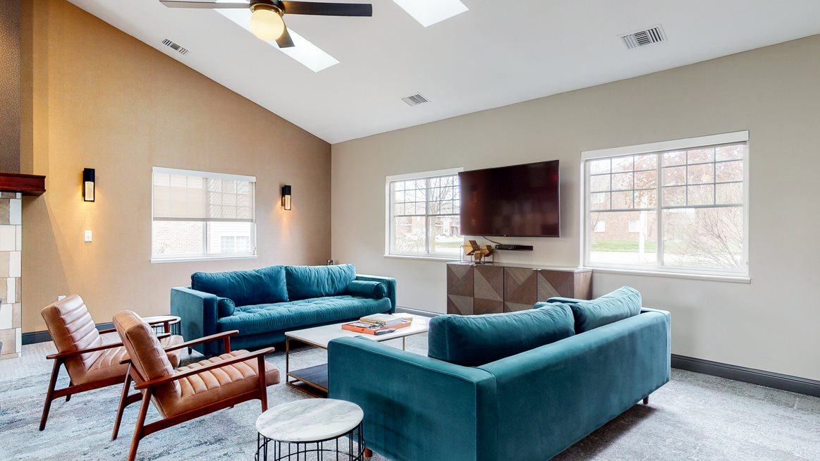 Casual sitting area with TV at the community clubhouse at The Northbrook Apartments