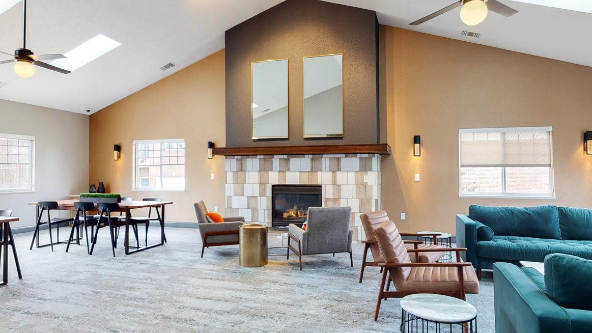 Large clubhouse with vaulted ceiling, fireplace and multiple sitting areas at the Northbrook Apartments