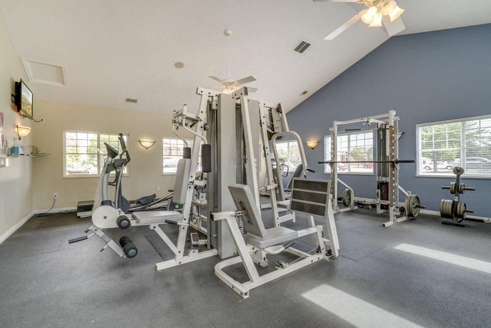 Spacious fitness center with cardio and resistance equipment at The Northbrook Apartments in Lincoln, NE