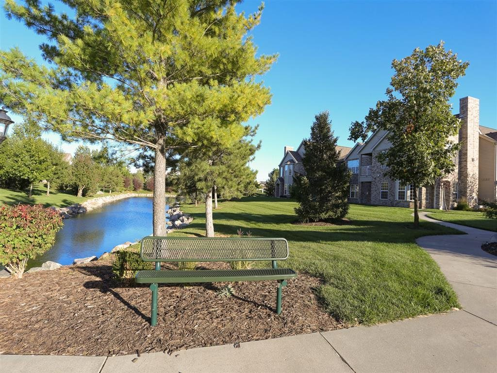 Exteriors-Sitting bench next to private pond at Stone Ridge Estates townhomes in Lincoln, NE