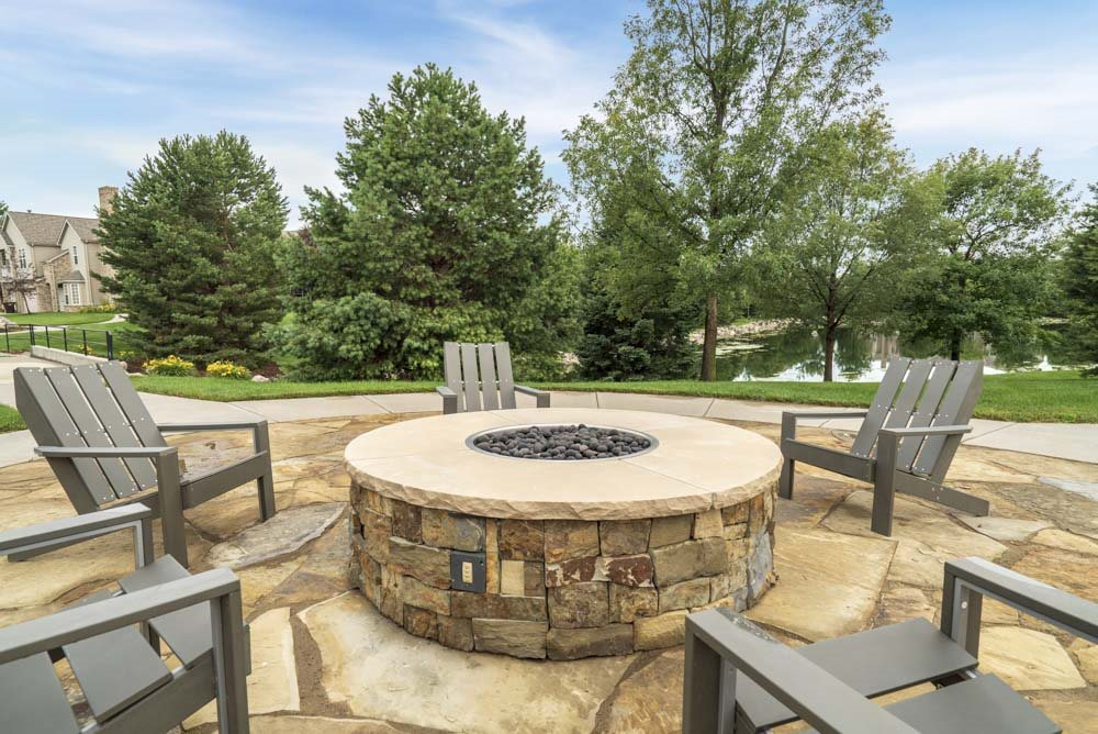 Outdoor fire pit and seating at Stone Ridge Estates