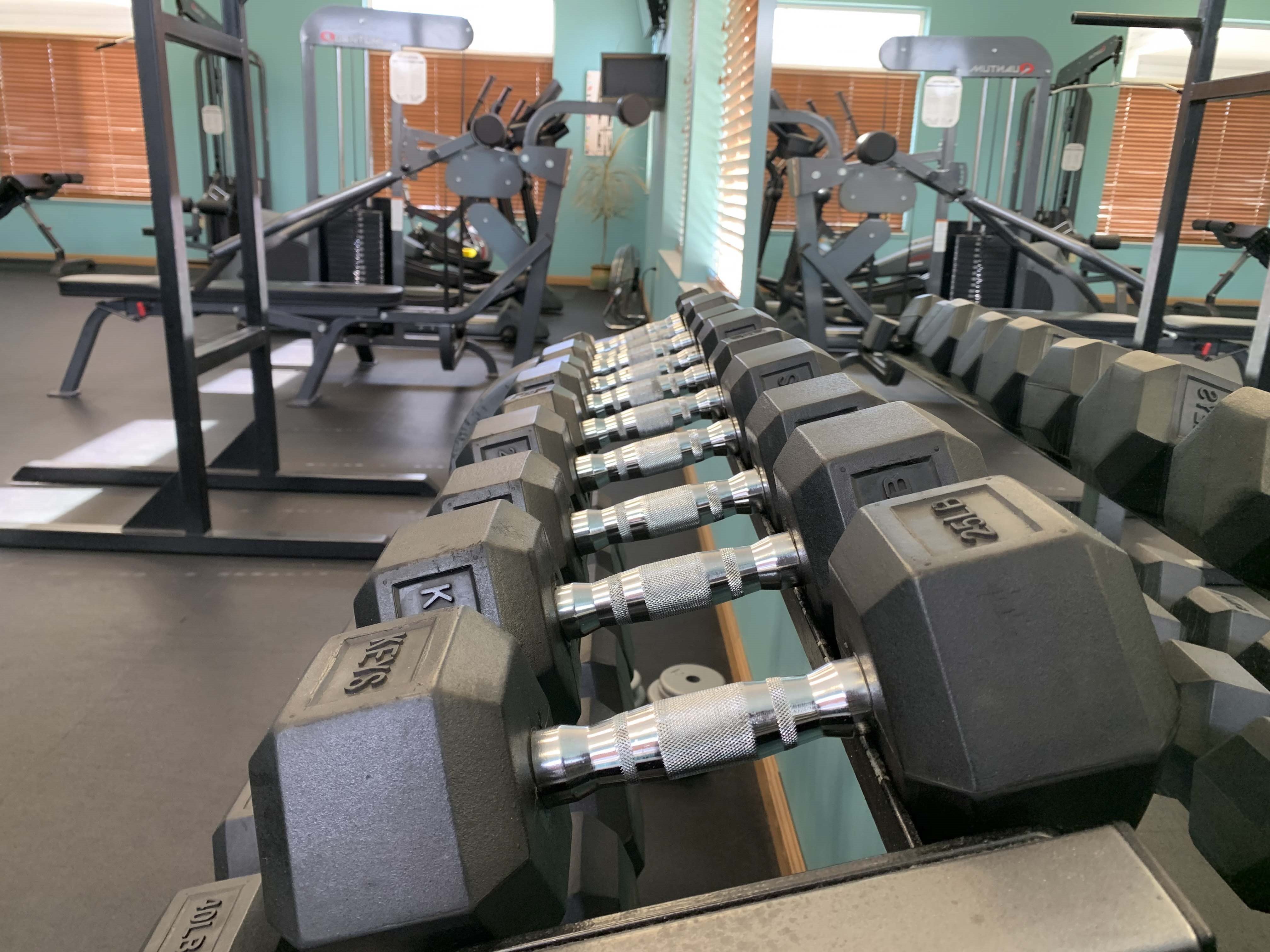 Free weights are a great option to help you stay active and fit in the exercise room at Stone Ridge Estates
