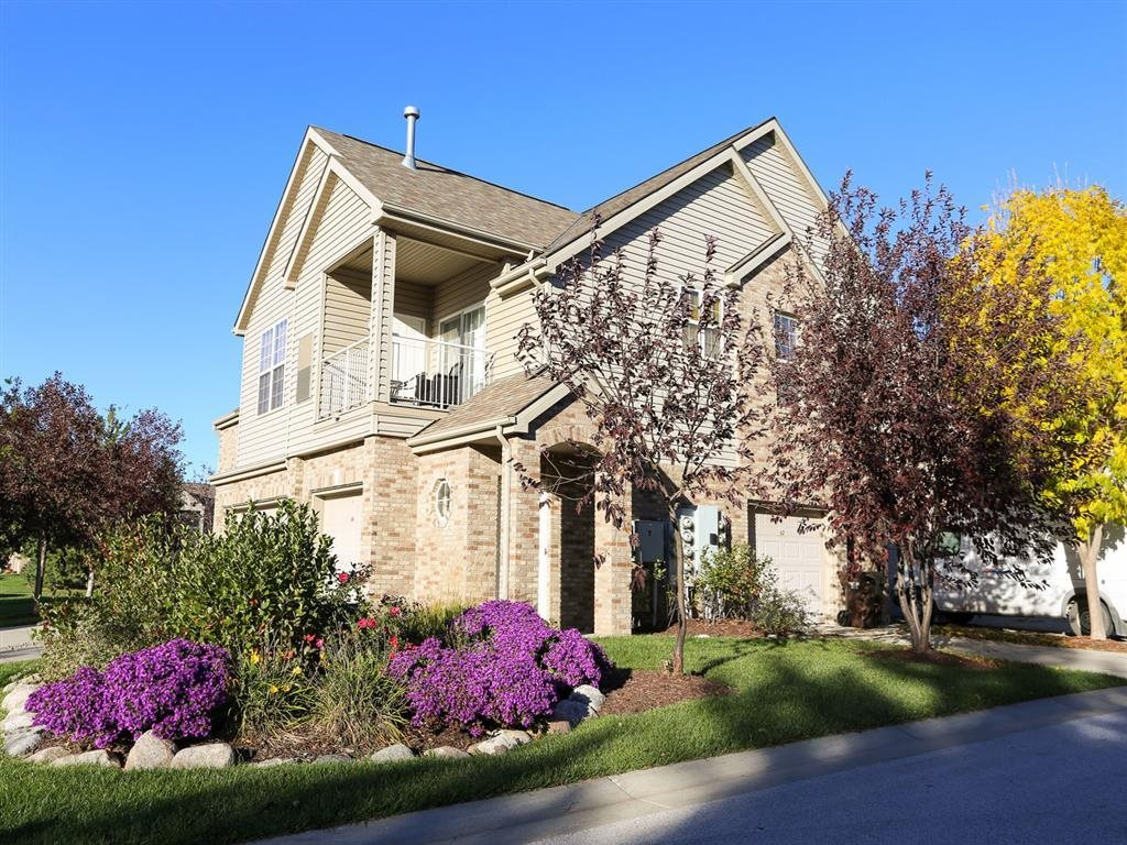 Exteriors-Stone Ridge townhomes exterior view with attached garage and private entrance