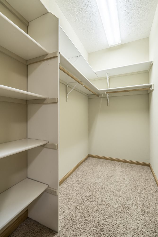 Interiors-Large walk-in closet with built-in shelving at Stone Ridge Estates in south Lincoln NE