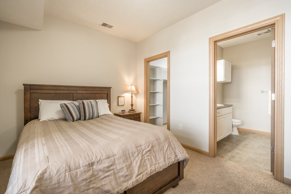 Large bedroom with attached bathroom and walk-in closet at Stone Ridge townhomes
