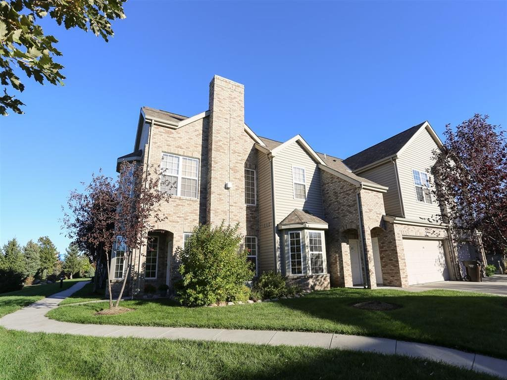 Exterior view of Stone Ridge townhomes with private entrance and attached garage